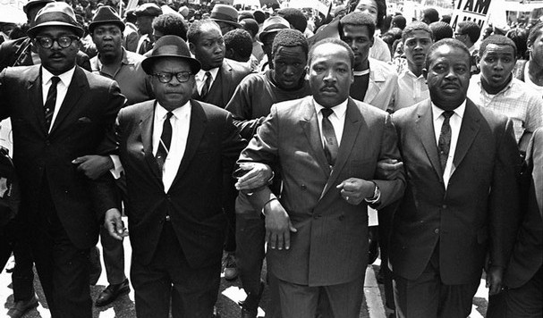 Dr. King marching with striking Memphis sanitation workers - 1968
